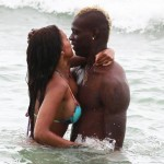Striker Mario Balotelli and his fiancee Fanny Neguesha show a public display of affection in the water in Miami Beach
