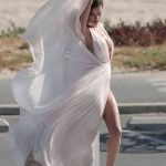 Alessandra Ambrosia experiences several wardrobe malfunctions during a secret photo shoot on the beach