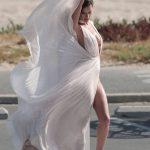 Alessandra Ambrosia experiences several wardrobe malfunctions during a secret photo shoot on the beach